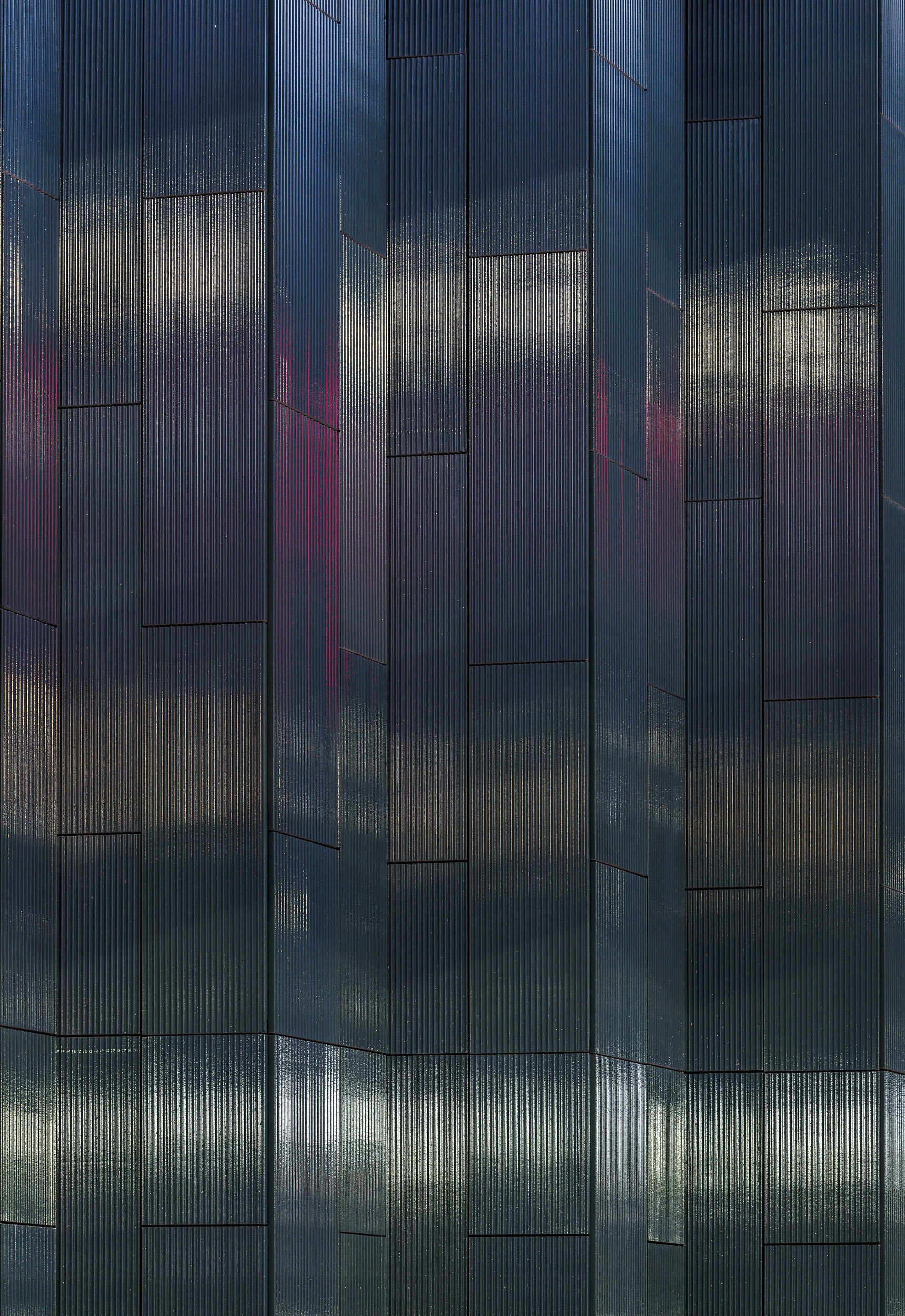 Architectural detail image that shows the cladding at night.