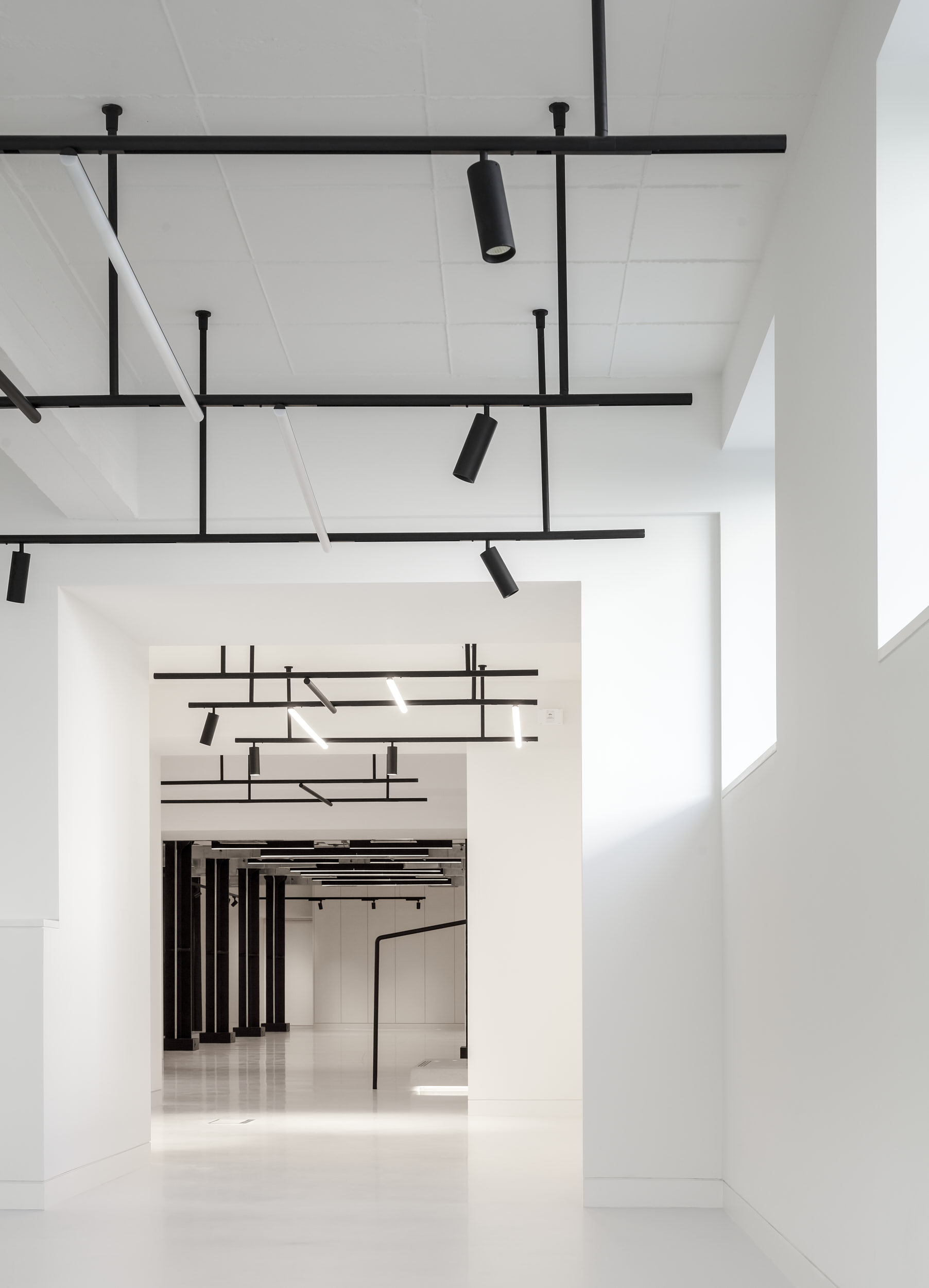 Office spaces are flooded by light from high level glazing.