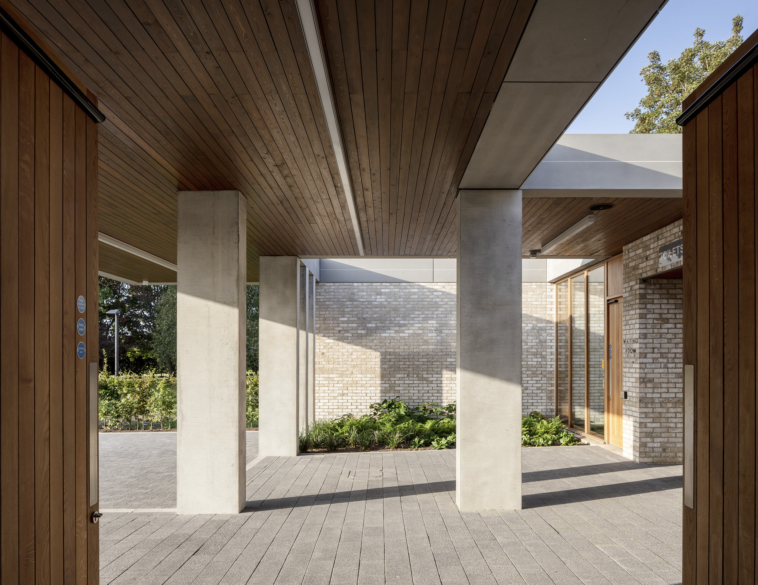 Entrance area with timber soffit and beautful pre-cast structural elements.