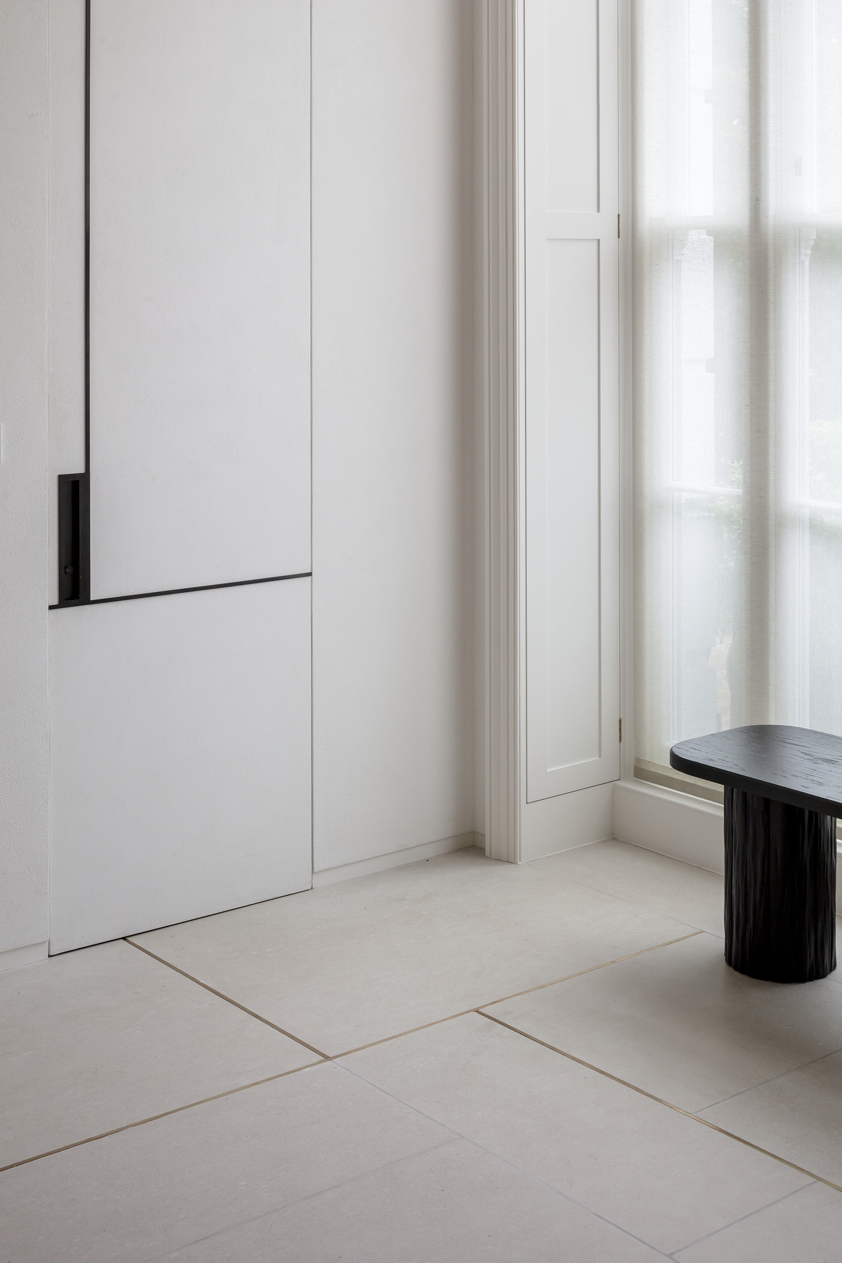 Photography showing inlaid metal floor detail and custom furniture and joinery.
