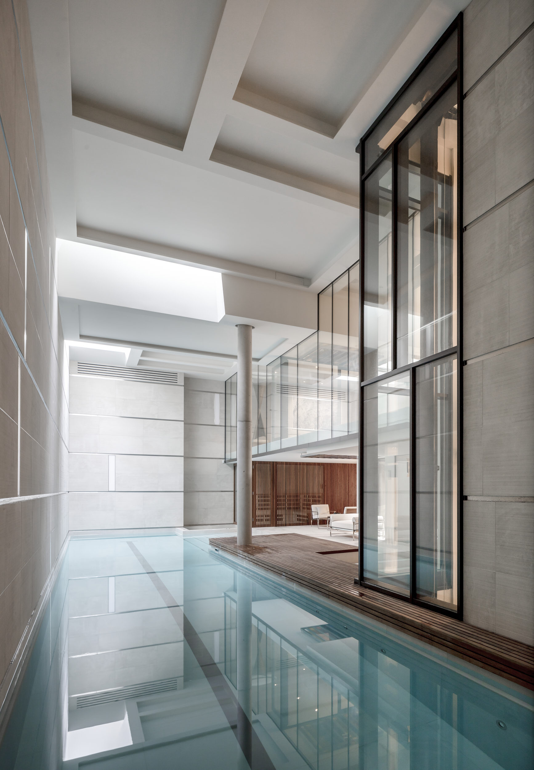 Stunning subterranean pool features variable lighting modes and rooflights.