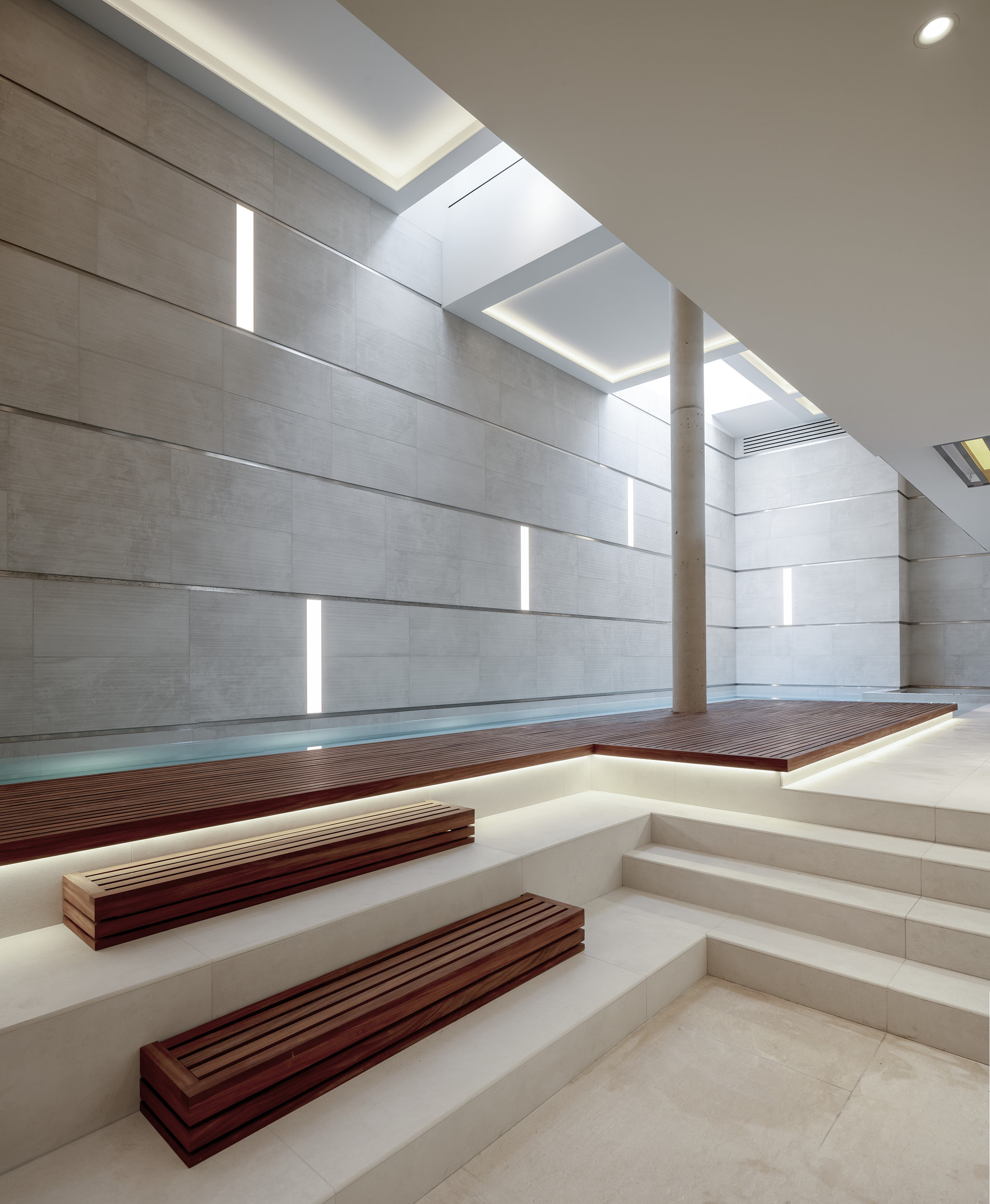 The subterranean pool features beautiful materials and sophisticated variable lighting modes.