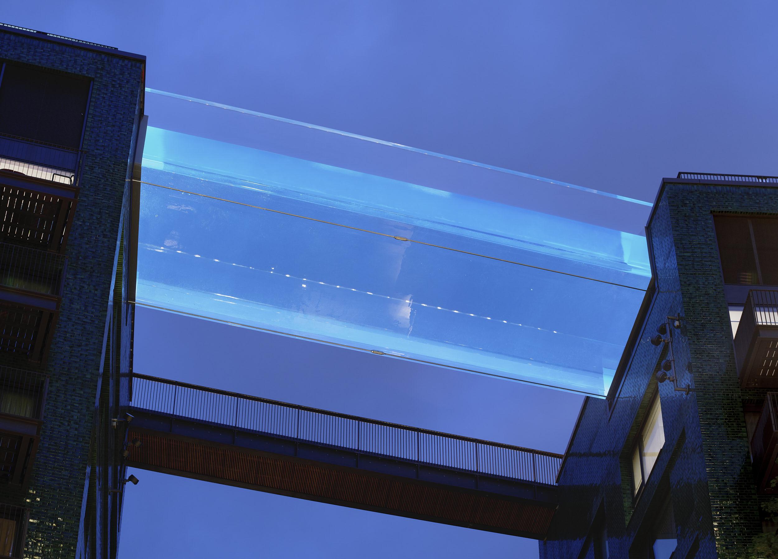 Night photography showing transparent pool architectrure.