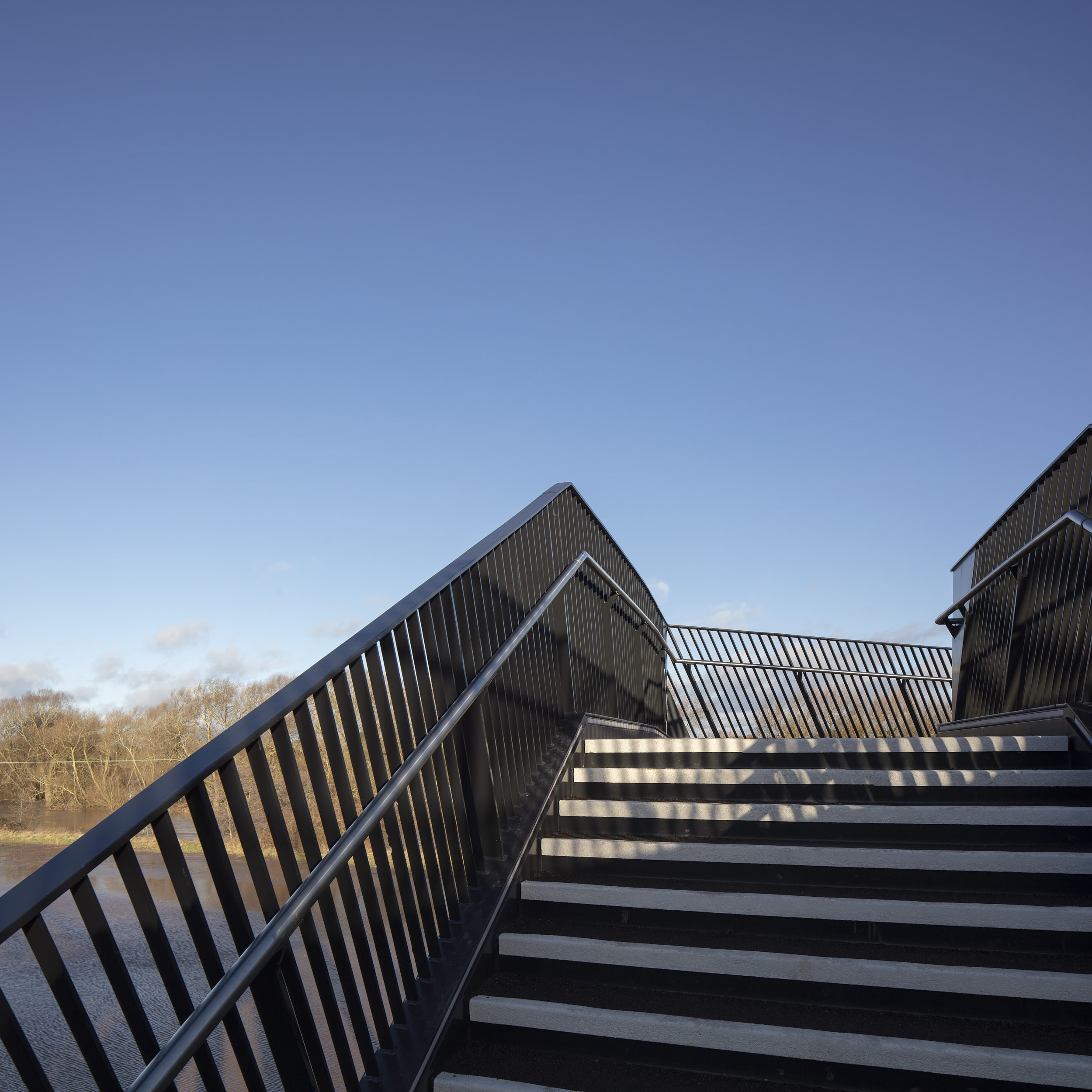 Architectural photography of the finely-detailed stair and balustrade.